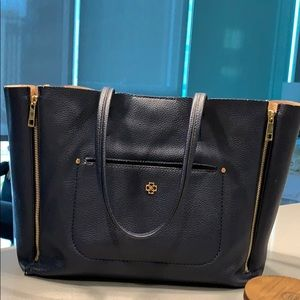 Navy blue and tan tote. Fits laptop. Slight wear.